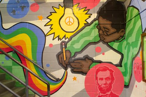 Mural of a student writing